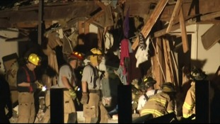 Firefighters at work in a damaged building in West, Texas