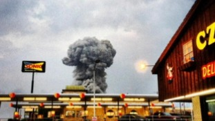 A mushroom cloud rises above the fertiliser plant