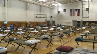 Camping beds in a gym at Abbott High School where evacuated people will spend the night