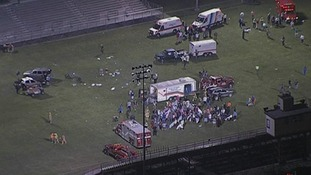 Victims of the blast are treated in the sports field of a nearby school