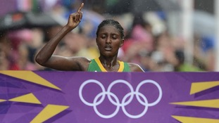 Tiki Gelana pictured crossing the finishing line to win the London 2012 women's marathon.