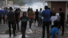 Tear gas was fired at anti-government protesters in the village of Diraz, west of Manama