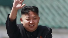 North Korea leader Kim Jong-un waves to the crowd