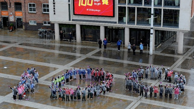 One hundred pupils from schools across Leeds form a 'human 100' in Millenium Square