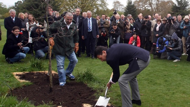 Lord Coe plants an oak tree to celebrate the UK's role in the birth of the modern Olympic movement.
