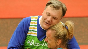 An exhausted looking Ed Balls MP at the finish line of the London Marathon.