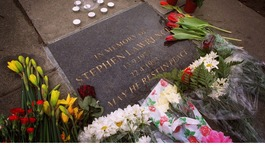 Flowers lie next to a commemorative plaque in Eltham, where teenager Stephen Lawrence was murdered in 1993.