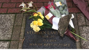 Flowers left on the memorial stone of Stephen Lawrence on Well Hall Road, Eltham