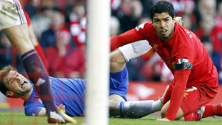 Liverpool's Luis Suarez (right) and Chelsea's Branislav Ivanovic