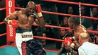 Evander Holyfield (L) recoils after Mike Tyson (R) bit his ear 