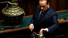 Italy&#x27;s former Prime Minister Silvio Berlusconi casts his ballot during the third day of the presidential election in the lower house.