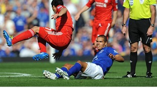 Everton's Jack Rodwell (floor) goes in for a tackle against Luis Suarez which earns him a red card for serious foul play