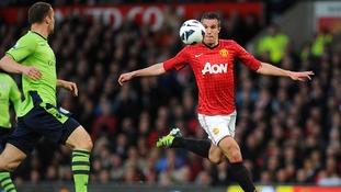 Robin van Persie shoots to score Man Utd's second goal