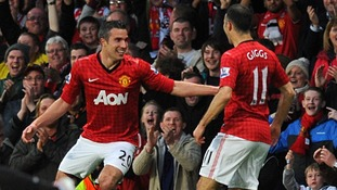 Robin van Persie (left) celebrates with his team-mate Ryan Giggs after scoring his team's second goal