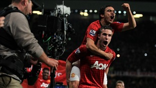 Manchester United's Robin van Persie celebrates with his team-mate Rafael da Silva