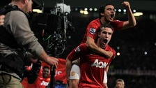 Manchester United's Robin van Persie celebrates with his team-mate Rafael da Silva