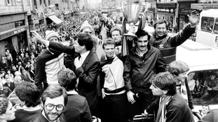 1983: Aberdeen captain Alex McLeish holds the European Cup Winners Cup, as Ferguson waves