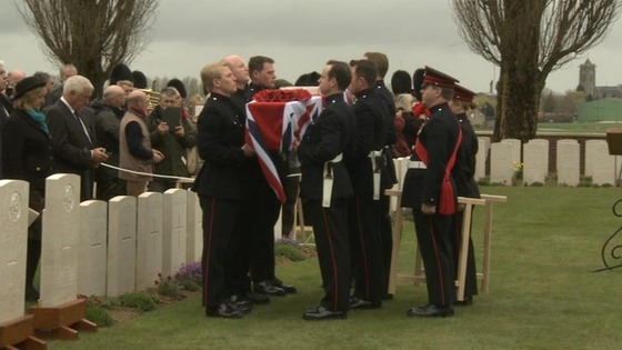 Members of the Honourable Artillery Company carry the coffin into the cemetery