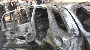 A damaged car outside the French Embassy in Tripoli