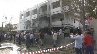 The damaged embassy after the bombing which injured two security guards