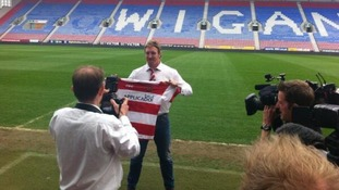 Powell with Wigan shirt