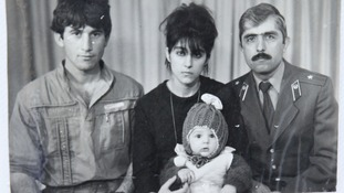 A photo, showing Tamerlan (C, bottom) Tsarnaev, accompanied by his father Anzor (L), mother Zubeidat and uncle Muhamad Suleimanov (R)
