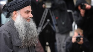 Abu Qatada surrounded by the media in London