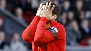 Luis Suarez reacts after a missed chance on goal at the weekend