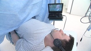 Hospital patients watch films during surgery