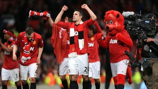Manchester United Robin Van Persie celebrates the clubs 20th league title