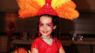 A bright outfit with feathers for Tia Woodall