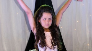 Tia Woodall strikes a pose at a beauty pageant