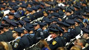 Police officers take their seats for the memorial service for Massachusetts Institute of Technology (MIT) police officer Sean Collier.
