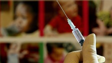 A nurse handles a syringe at a medical centre in Ashford, Kent