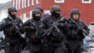 SWAT teams seen during the hunt for the bomb suspects
