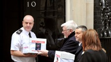 Family with boxes at no 10