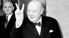 Mr Winston Churchill gives a 'victory' sign whilst on board the Cunard liner Queen Mary, on which he was sailing to New York.