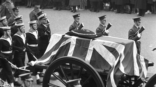 Sir Winston Churchill's flag-draped coffin on the gun-carriage in the State funeral procession.