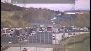 Traffic queueing on M62 after minibus crash