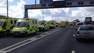 Ambulances on the scene at the site of the M62 crash