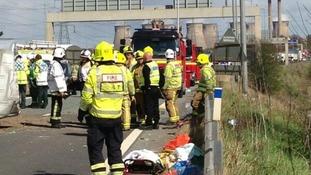 Fire crews prepare to leave M62 minibus crash scene
