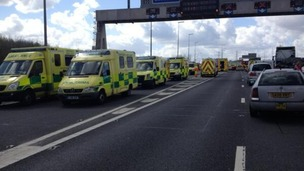 Emergency services at M62 minibus crash