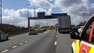 Emergency services at M62 minibus crash