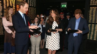 The Duke and Duchess of Cambridge and Prince Harry are presented with wands at the end of the Harry Potter Tour.