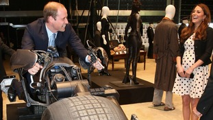 The Duke and Duchess of Cambridge share a joke as he rides the 'Batpod'.