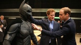 The Duke of Cambridge and Prince Harry discuss the sartorial merits of the Bat suit.