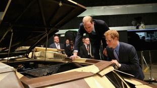 The Duke of Cambridge and Prince Harry look at the 'Tumbler.'