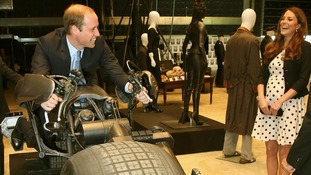 Prince William tries out the 'Batpod' during their visit to Warner Bros studios