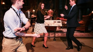 The Duke and Duchess of Cambridge get some tips on duelling with their wands.
