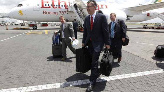 Randy Tinseth, Vice President of Marketing for Boeing (front), walks from an Ethiopian Airlines' 787 Dreamliner after it lands in Nairobi